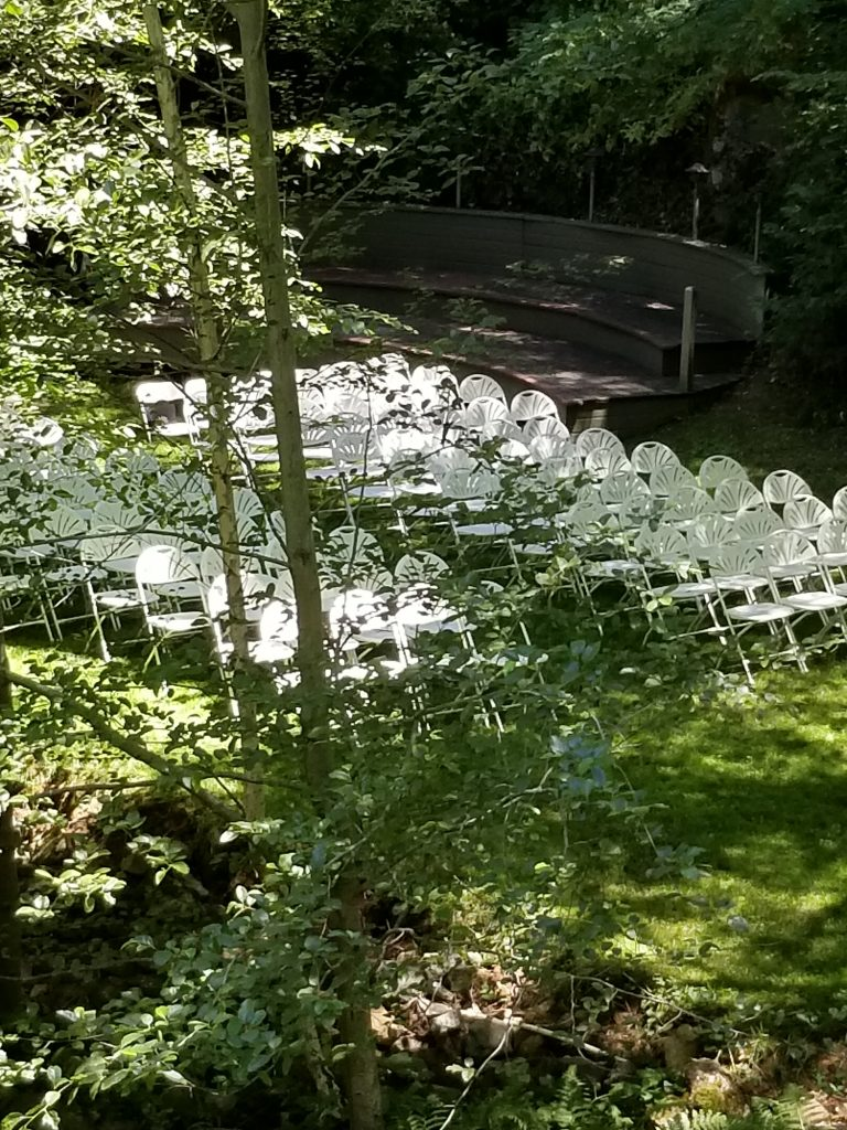 "White chairs, lush lawn, waterfall whispering... ""Welcome to our 25th. annual shareholders meeting..."